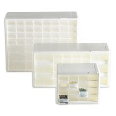 The white is better than that gray, and TCS offers drawer dividers too.