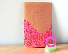 Remember all of your inspired decorating ideas by jotting them down in the Neon Pink Waves Journal ($14).