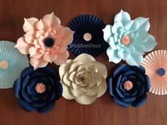 Paper flower sets. I'm obsessed with these colors! Mixing pinwheels and flowers makes beautiful decor for any special event.