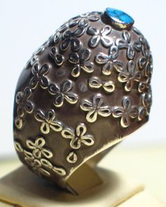 Silver dome ring from Afghanistan with appliqué decorations and topped with a small Turqoise.