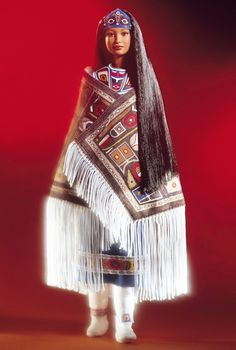 Northwest Coast Native American Barbie is from the panhandle area of Southeast Alaska, wearing a ceremonial dress with a Chilkat Robe, traditionally woven from cedar bark and mountain goat hair.