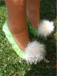 """Tinkerbell Fairy Costume Slippers-  just traced around my DD foot, added about 2""""(5cm) all round, then using 3 step zig zag I applied the elastic. I made a couple of cute pom poms from glitter wool and attached them to the slippers by hand."""