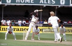 Sport. Cricket. First Cornhill Test Match. Trent Bridge, Nottingham. 2nd-7th June 1988. England v West Indies. West Indies' Curtley Ambrose hits out at a delivery from England's Graham Dilley.