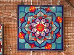hand glazed tile Mandala mural set & grouted into one of our custom made hand welded metal frames. Ready to hang, great for outdoor use, will never fade. Fired at over 1800 degrees in our studio in downtown Tucson, AZ. Original artwork by Carly Quinn