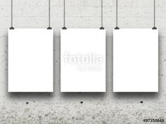 Three hanged paper sheet frames with clips on grey concrete wall background