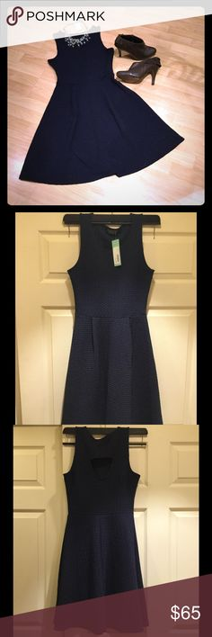 Stitch Fix Papermoon Textured dress I bought this dress to use as a bridesmaid dress, but ended up going with a different one.  Super cute and extremely comfortable with cute cut out in back. Navy blue. Papermoon Dresses Midi