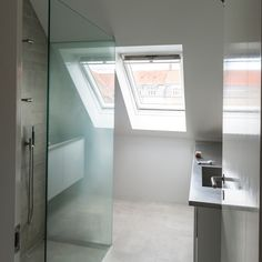 Save To My Moodboards Contemporary loft shower room Have extra loft space? Create a walk-in wet room. This bathroom has a clean, contemporar...