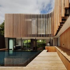 Wooden plans on facade. And their reflection in the pool. And the cosy space inside -- that's it!