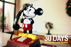 """30 Days until our next Disney Vacation!  We are counting the days to our next Disney trip with our favorite pics taken at the parks. This photo is of a Mickey Mouse phone located at Guest Services in Epcot. Let us know if you """"Like""""."""