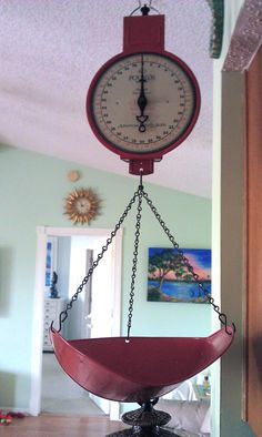 I love my old fashion hanging scale in the kitchen