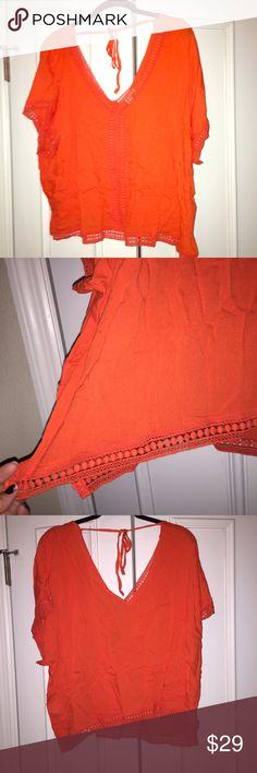 Plus size crochet trimmed top in orange. Forever 21 plus size crochet trimmed top in orange. New, never worn with tags and original shipping bag. Purchased online and could not return. Forever 21 Tops Blouses