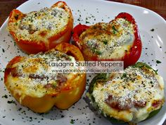Lasagna Stuffed Peppers – Low Carb, Gluten-Free Recipe with red bell pepper, green bell pepper, yellow bell pepper, orange bell pepper, meat sauce, ricotta cheese, mozzarella cheese, parmesan cheese, italian seasoning