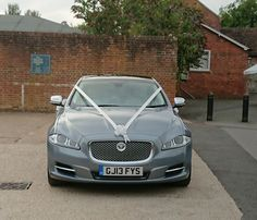 Our Jaguar XJ waiting at. The Secret Garden in Ashford for the bride & groom.