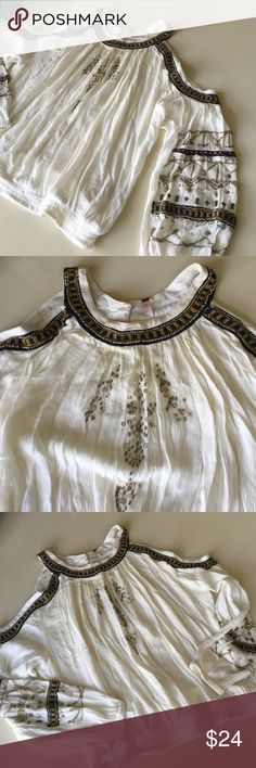 Free Prople cold shoulder beaded boho hippie top In pre owned condition. Some beads arenas sing and there's a mark on the back in picture number 4. The back button around the neck is a dark color and a little loose, but there's two buttons and you only need one. Price is LOW because of condition. Free People Tops