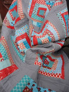 Gray, red and turquoise quilt