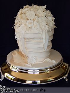 This was my first cake for 2013, over 50 sugar flowers and 30 leaves went into making this cake. The Bride asked for an Akubra Hat to be on the cake to represent the Groom. The cake flavours were Dark Chocolate Peppermint Mud Cake, White Chocolate Coconut Mud Cake and Cherry Ripe Mud Cake.