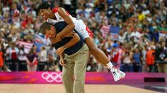 Angel McCaughtry #8 of United States jumps on the back of head coach Geno Auriemma after the United States defeats France 86-50 to win the gold medal in the Women's Basketball Gold Medal game on Day 15 of the London 2012 Olympic Games at North Greenwich Arena