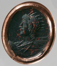 Gemme: Büste des Sol. Römisch, Kaiserzeit 2. - 3. Jh. n. Chr. Heliotrop, dunkelgrün. In moderner Goldfassung als Ring.