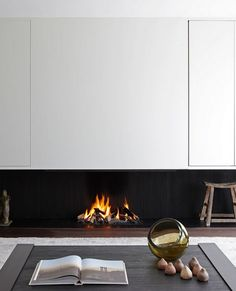 Sleek fireplace on wooden base.