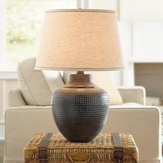 Inspired by Western and Southwest style design, this bronze table lamp features a handsome hammered metal base.