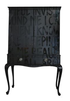 Matte paint for the furniture and glossy paint in the same color for the writing. I LOVE, Love, love this idea!
