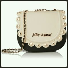 """""""New"""" Betsey Johnson Color Block Cross-Body Pretty cream and black handbag. Magnetic closure, scalloped trim and gold hearts around flap, faux black leather and chain strap., logo hardware on front. Inside black with roses. Strap may be used as one long strap or use as a double strap. Great color combo for all seasons. Measures approximately 8"""" x 9"""" x 3.5"""". Betsey Johnson Bags Crossbody Bags"""