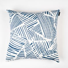 Composed of brush strokes arranged geometrically, this print injects a painterly touch to a room. Mix things up and display the reverse side, which features an appliquéd, patterned stripe against a ne