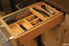 Wood Double Tiered Cutlery Insert - Alder wood cutlery dividers are stacked for #organized #storage.  The drawer fully extends, exposing the top tray which can be fully pushed back into the cabinet to expose the bottom storage tray.  www.bellmontcabinets.com