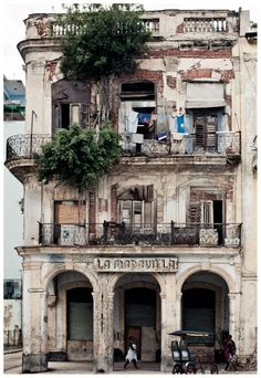 Cuba-I'd like to see it before all the beautiful colonial buildings crumble to dust under the present government.