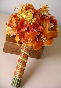 This would be a good start, too. I want more ivory / white in mine, but I like some orange, too. Boutonniere is too big. I think M should have a white / ivory boutonniere too. Orange Tiger Lily  Hydrangea BOUQUET & BOUTONNIERE SET accented with Yellow Polyanthus for Late Summer Fall Autumn Wedding. $155.00, via Etsy.
