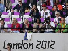 British Prime Minister David Cameron (3rd row from bottom, R) sits with Britain's Prince William and Kate Middleton, Duchess of Cambridge, during the London 2012 Olympic Games at the Olympic Stadium August 4, 2012.