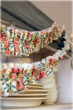 how to make a ruffle fabric banner. Perfect for a shabby chic party. www.bridgeywidgey.com