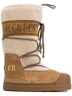 Shop Moncler moon boots.