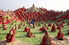 Artist Creates 500 Santa Sand Sculptures