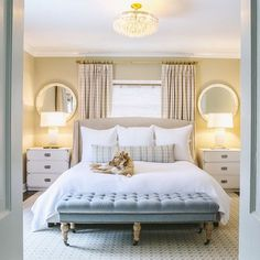 Double Doors Open To A Master Bedroom Featuring A Camel Colored Bed With  Silver Nailhead Trim Dressed In Soft White Shams And Duvet Placed In Front  Of ... Part 92