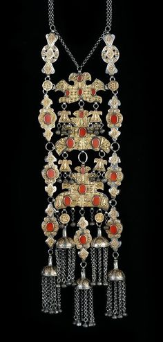 "This particular type of ornament is widely seen as among the very best produced by the Turkoman, in this case the Yomud people (characteristically so, in style and workmanship). It is a heavy and imposing plait decoration (""satschmondschuk"") worn on the back, made of gilt silver and carnelians. One of our best Turkoman pieces, without a doubt. Published in Truus Daalder, *Ethnic Jewellery and Adornment*, p. 353."