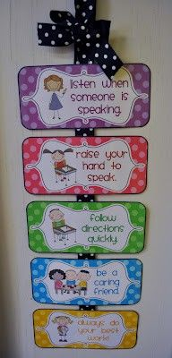 Cute display to remind students of class rules, including pictures of expected behavior.