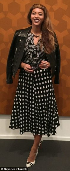 So chic: The singer mixed black and white prints with a leather jacket on her cultural day...