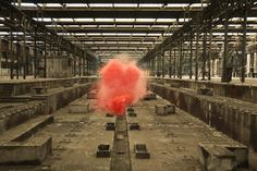 Colorful smoke bomb in industrial warehouse by Filippo Minelli