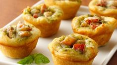 biscuits, pesto, cheese and tomato app. So yummy and easy. Double the recipe to make enough for 10 people.