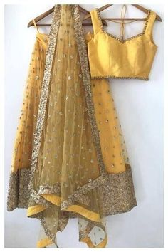 Yellow Embroidered Attractive Party Wear Lehenga Choli with Matching Color unstiched blouse. It contained the Embroidered work with inner. The Lehenga can be customized up to bust size 44 , Lehenga Length 48 , Waist size 38 , and Dupatta size Mtr. Indian Wedding Outfits, Bridal Outfits, Indian Outfits, Blouse Lehenga, Lehenga Choli, Gold Lehenga, Indian Attire, Indian Wear, Saris