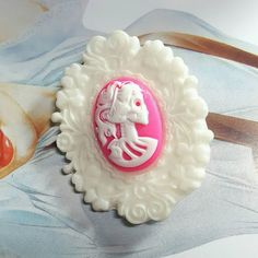 Only $5.99! - Ultra Glam Large White Resin Filigree Hot Pink Skull Girl Hair Clip, Vertical Sugar Skull Hair Clip, Resin Skull Girl Cabochon Cameo Hair Clip, White & Hot Pink Skeleton Girl Cameo Hair Accessory, Oceanic Hair Clips, Resin Cabochon Hair Jewelry, Goth Sugar Skull Hair Clip, Affordable Jewelry Gifts, Unique Holiday Gifts, Huge End of the Year Sale - FREE USA SHIPPING https://www.etsy.com/listing/496621739/large-white-resin-filigree-hot-pink