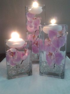 A set of three square vases with purple orchids floating in water perfect for unique wedding reception centerpieces or home decor by WreathsByDiane on Etsy https://www.etsy.com/listing/154449265/a-set-of-three-square-vases-with-purple