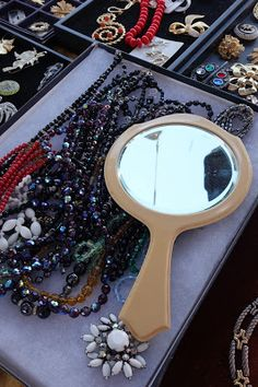 Display jewelry like they would in a  boutique and have some mirrors handy {including a full length one if there are  a lot of clothes on sale}.