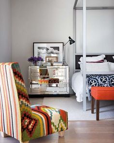 Um, I die for a mirrored side table. And the colors just pop off the simple white backdrop. Mixed patterns do it for me too!