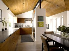 Home remodel by Seattle architect and interior designer, Garret Cord Werner which features modern and contemporary kitchen design.