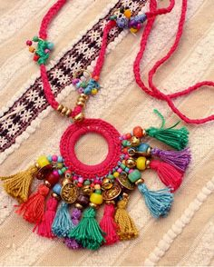 Multicolored hippie necklace multi tassels, coins and bells. Thread Jewellery, Tassel Jewelry, Textile Jewelry, Fabric Jewelry, Handmade Jewelry Designs, Handmade Accessories, Handmade Necklaces, Fabric Necklace, Diy Necklace