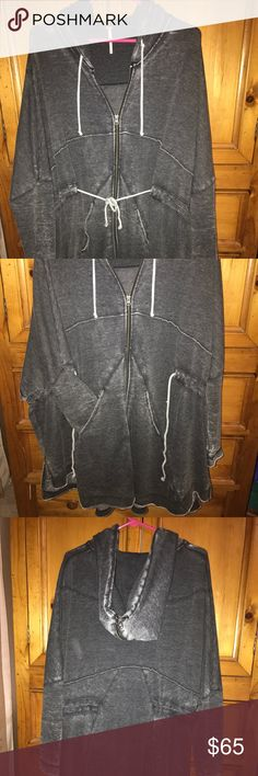 Free People Long Cardigan Zip Up Hoodie Black M This is an adorable long black hooded cardigan zip up jacket from Free People retailing for $128. Worn once or twice in excellent condition.  I loved that it hangs really long to wear over leggings.  I bought it in white too so I don't need it in two colors. There is a drawstring at the wait that can be cinched closed or let loose to hang open. So cute! The black color is meant to look faded and distressed. Purchased spring of 2017. Free People…