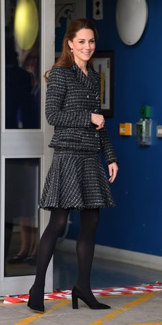 While visiting a children's hospital, Kate Middleton wore a Dolce & Gabbana tweed set with black stockings, and pointed-toe heels. Dolce & Gabbana, Dolce And Gabbana Suits, Kate Middleton Stil, Estilo Kate Middleton, Kate Middleton Outfits, Royals, Stil Inspiration, Fashion Inspiration, Princesa Kate Middleton