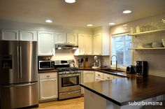 A very nice modest kitchen remodel.  Painted white cabinets, fabulous dark wood countertops.